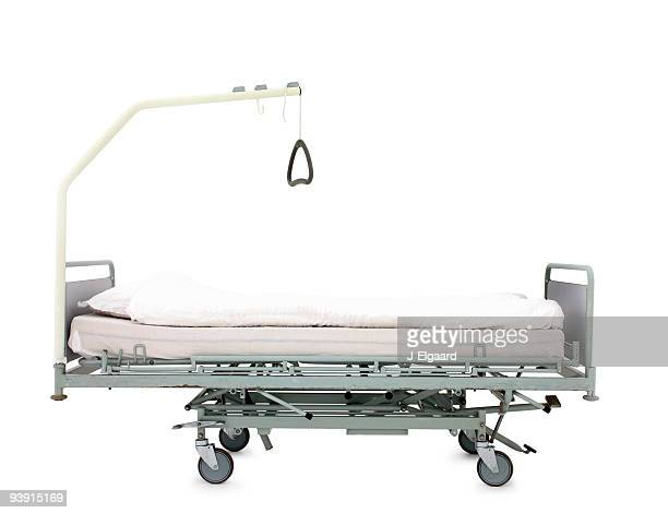 Hospital bed on wheels over white