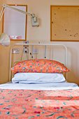 Hospital bed with multicolored bedding