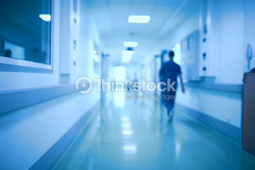 Hospital corridor and doctor as a blurred defocused background : Stock Photo