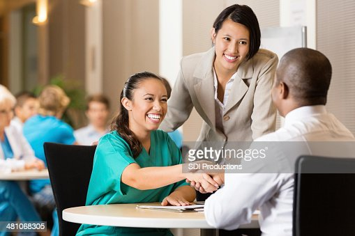 Hospital employee conducting job interview with nurse