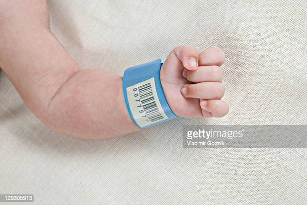A hospital ID bracelet on a baby's wrist