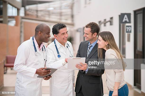 Hospital manager talking to doctors