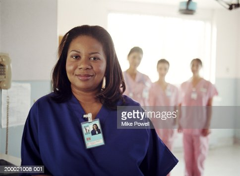 Hospital nurses, focus on nurse in blue uniform