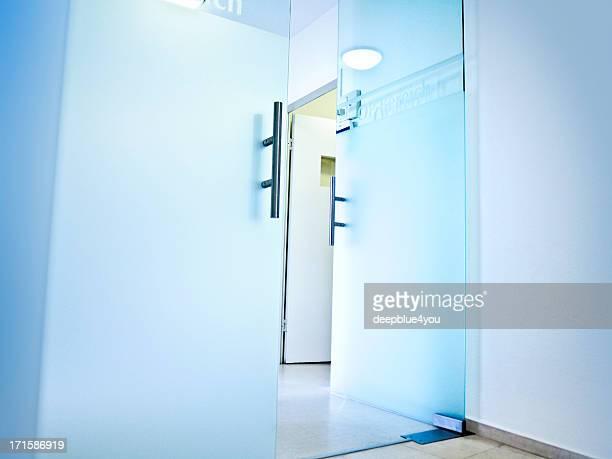 Hospital- open glass doors to the Operation area