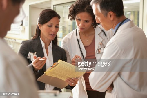 Hospital staff discussing patient charts