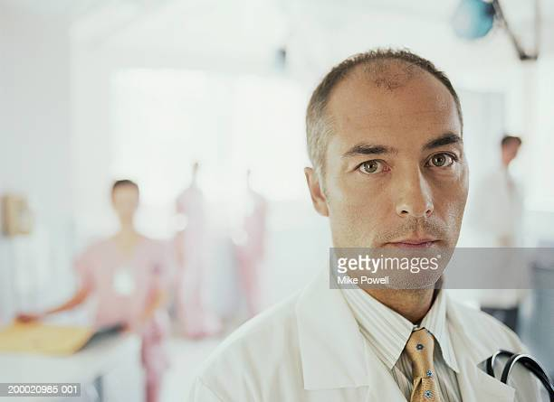 Hospital staff, focus on doctor in foreground
