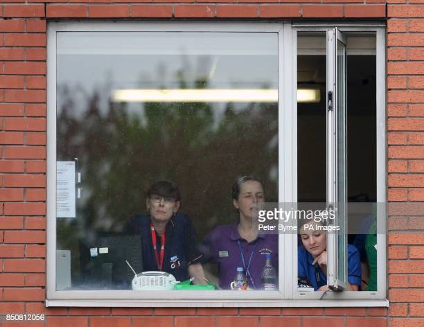 Hospital staff from Liverpool Women's Hospital look out of the window as Coleen Rooney who gave birth to Klay Anthony Rooney at 211am leaves hosptal