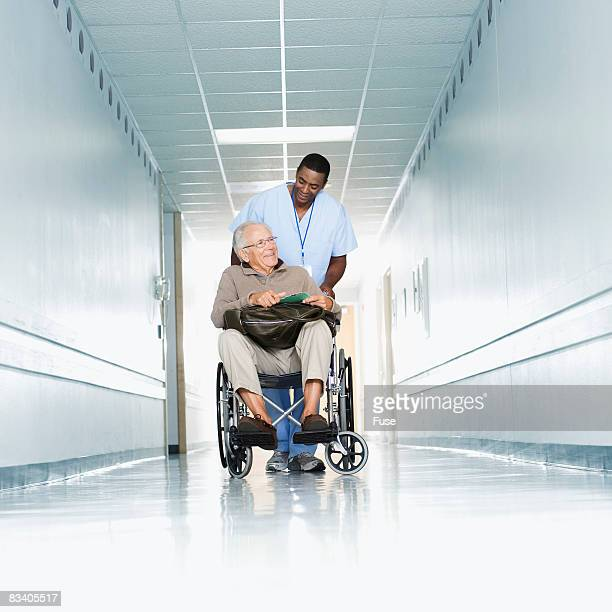 Hospital Staff Pushing Patient in Wheelchair
