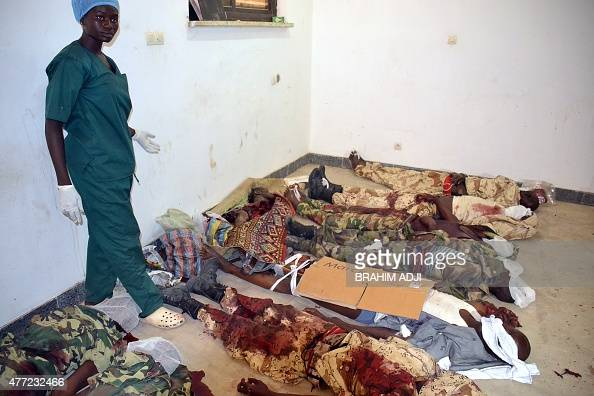 A hospital worker lays the bodies of those killed in twin suicide bombings on June 15 2015 in a hospital in N'Djamena in which 23 were killed...