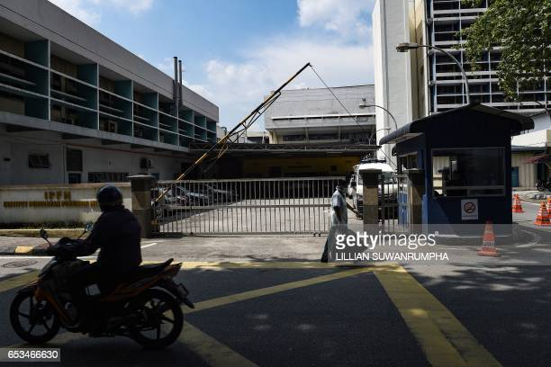 A hospital worker takes out the trash outside the forensics wing of the Hospital Kuala Lumpur where the body of Kim JongNam is being held in Kuala...