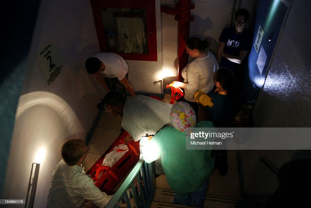 Hospital workers evacuate patient Deborah Dadlani from NYU Langone Medical Center during Hurricane Sandy the evening of October 29, 2012 in New York City. More than 200 patients were evacuated from the hospital after backup generators failed due to flooding following a power outage. The storm has claimed at least 16 lives in the United States, and has caused massive flooding across much of the Atlantic seaboard. US President Barack Obama has declared the situation a 'major disaster' for large areas of the US East Coast including New York City.