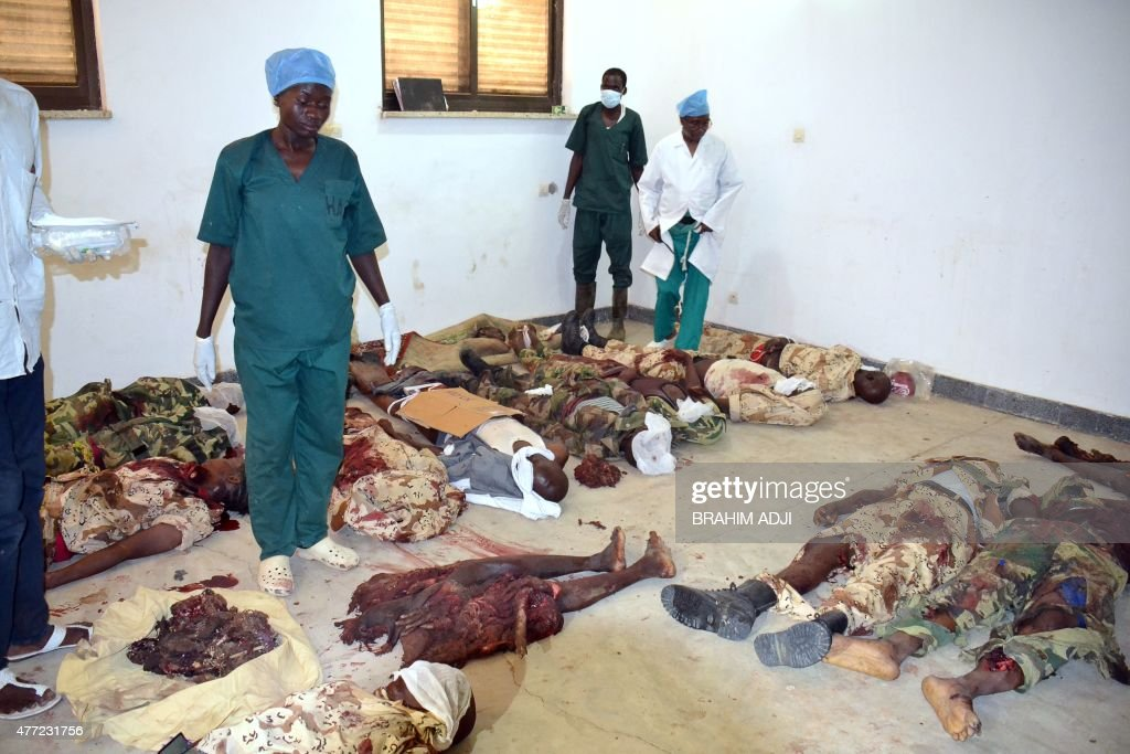 Hospital workers lay the bodies of those killed in twin suicide bombings in a hospital in N'Djamena on June 15 in which 23 were killed Twentythree...