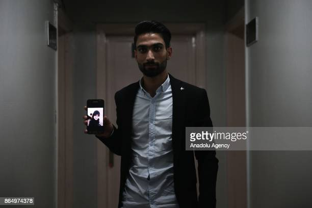 Hossain alDarvish shows a photo of his fiancee from his mobile phone in Gaziantep Turkey on October 20 2017 Eight Syrian teenagers forced to be...