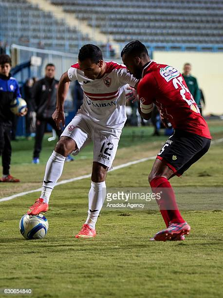 Hossam Ashour of Al Ahly in action against Hosny Fathy of Zamalek during the Egypt Premier League match between Al Ahly and Zamalek at the Petro...