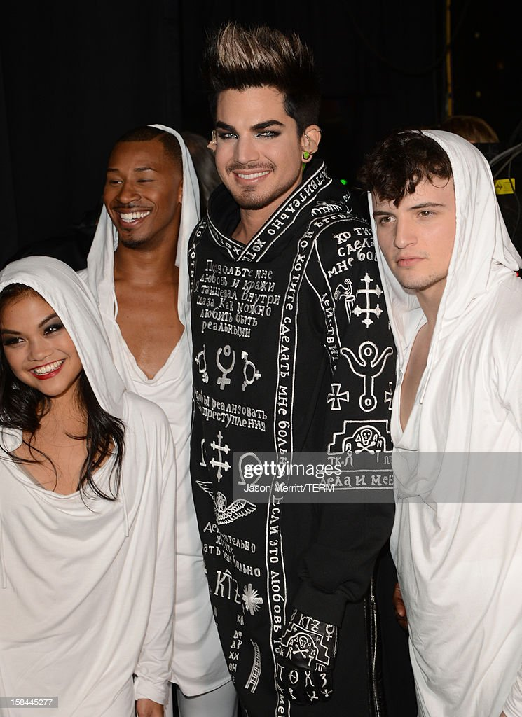 Host <a gi-track='captionPersonalityLinkClicked' href=/galleries/search?phrase=Adam+Lambert&family=editorial&specificpeople=5706674 ng-click='$event.stopPropagation()'>Adam Lambert</a> (center) attends 'VH1 Divas' 2012 held at The Shrine Auditorium on December 16, 2012 in Los Angeles, California.