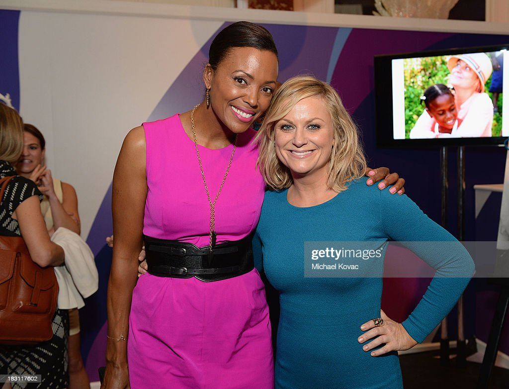 Host <a gi-track='captionPersonalityLinkClicked' href=/galleries/search?phrase=Aisha+Tyler&family=editorial&specificpeople=202262 ng-click='$event.stopPropagation()'>Aisha Tyler</a> and honoree <a gi-track='captionPersonalityLinkClicked' href=/galleries/search?phrase=Amy+Poehler&family=editorial&specificpeople=228430 ng-click='$event.stopPropagation()'>Amy Poehler</a> attend Variety's 5th Annual Power of Women event presented by Lifetime at the Beverly Wilshire Four Seasons Hotel on October 4, 2013 in Beverly Hills, California.