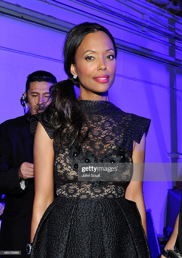Host <a gi-track='captionPersonalityLinkClicked' href=/galleries/search?phrase=Aisha+Tyler&family=editorial&specificpeople=202262 ng-click='$event.stopPropagation()'>Aisha Tyler</a> attends the 19th Annual Critics' Choice Movie Awards at Barker Hangar on January 16, 2014 in Santa Monica, California.