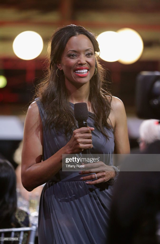 Host <a gi-track='captionPersonalityLinkClicked' href=/galleries/search?phrase=Aisha+Tyler&family=editorial&specificpeople=202262 ng-click='$event.stopPropagation()'>Aisha Tyler</a> with Champagne Nicolas Feuillatte at the 19th Annual Critics' Choice Movie Awards at Barker Hangar on January 16, 2014 in Santa Monica, California.