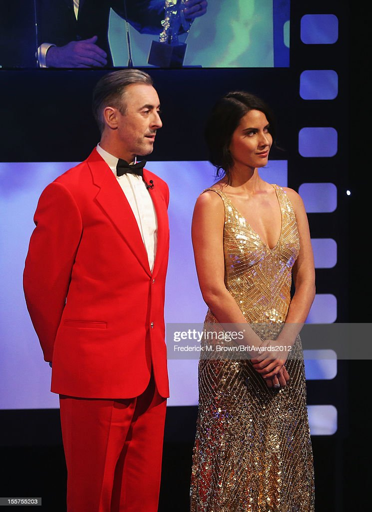 Host Alan Cumming and actress Olivia Munn onstage at the 2012 BAFTA Los Angeles Britannia Awards Presented By BBC AMERICA at The Beverly Hilton Hotel on November 7, 2012 in Beverly Hills, California.