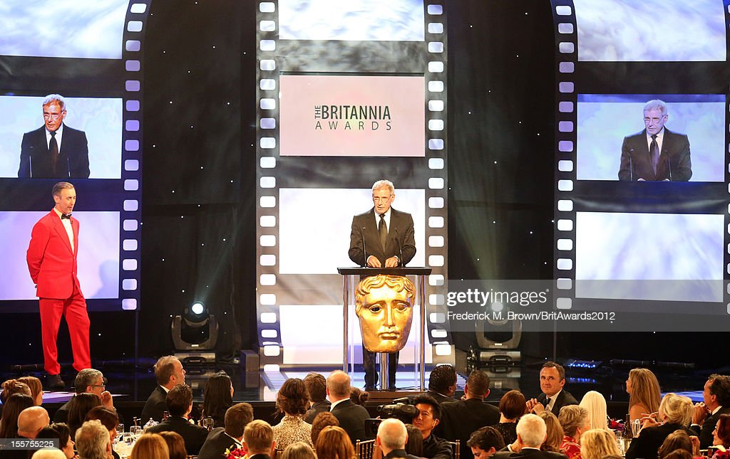 Host Alan Cumming and presenter Harrison Ford speak onstage at the 2012 BAFTA Los Angeles Britannia Awards Presented By BBC AMERICA at The Beverly Hilton Hotel on November 7, 2012 in Beverly Hills, California.