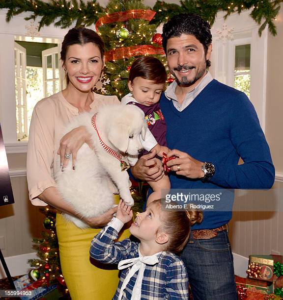 Host Ali Landry daughter Estela son Marcelo and filmmaker Alejandro Gomez Monteverde attend the 'Santa Paws 2 The Santa Pups' holiday party hosted by...