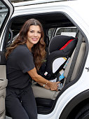 Host Ali Landry demonstrates how to install an Evenflo car seat during Favordby's 3rd annual Red CARpet Safety Awareness Event presented by Evenflo...