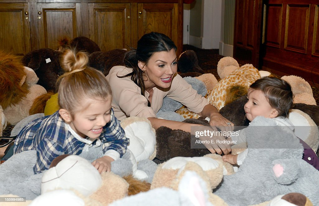 Host <a gi-track='captionPersonalityLinkClicked' href=/galleries/search?phrase=Ali+Landry&family=editorial&specificpeople=543155 ng-click='$event.stopPropagation()'>Ali Landry</a> (C) with her daughter Estela and son Marcelo attend the 'Santa Paws 2: The Santa Pups' holiday party hosted by Disney, Cheryl Ladd, and <a gi-track='captionPersonalityLinkClicked' href=/galleries/search?phrase=Ali+Landry&family=editorial&specificpeople=543155 ng-click='$event.stopPropagation()'>Ali Landry</a> at The Victorian on November 10, 2012 in Santa Monica, California.