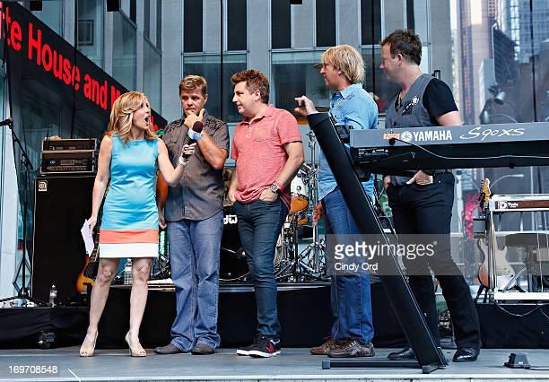 Host Alisyn Camerota interviews Richie McDonald Michael Britt Keech Rainwater and Dean Sams of the band Lonestar during 'FOX Friends' All American...