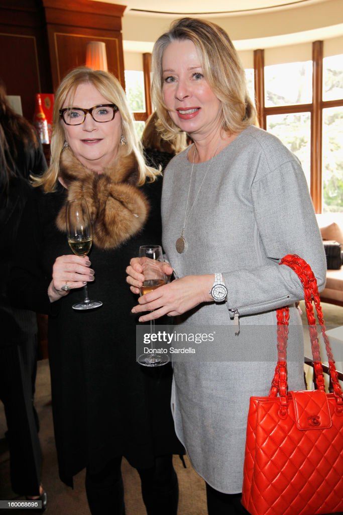 Host Amanda Mackey and writer Diane English attend the Champagne Taittinger Women in Hollywood Lunch hosted by Vitalie Taittinger at Sunset Tower on January 25, 2013 in West Hollywood, California.