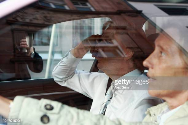 TV host and weather expert Joerg Kachelmann and his lawyer Andrea Combe arrive at the court on day six of his trial on October 4 2010 in Mannheim...