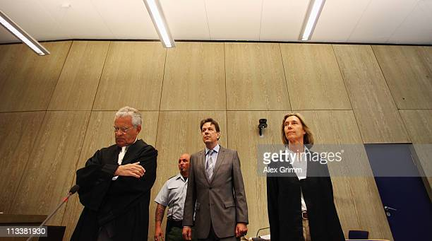 TV host and weather expert Joerg Kachelmann and his lawyers Johann Schwenn and Andrea Combe wait for the beginning of day 38 of Kachelmann's trial on...