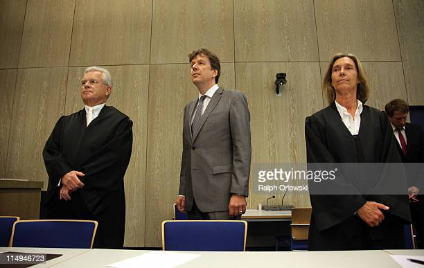 TV host and weather expert Joerg Kachelmann and his lawyers Johann Schwenn and Andrea Combe wait for the beginning of day 44 the day of the...