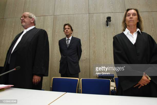 TV host and weather expert Joerg Kachelmann and his lawyers Reinhard Birkenstock and Andrea Combe wait for the lecture of the complaint on day one of...