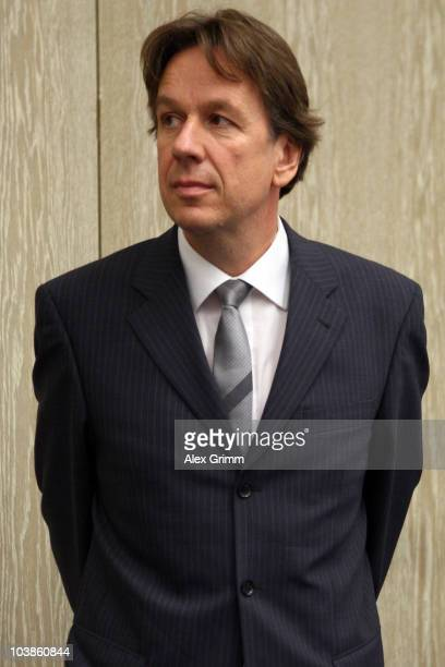 TV host and weather expert Joerg Kachelmann waits for the lecture of the complaint on day one of his trial at the district court Mannheim on...