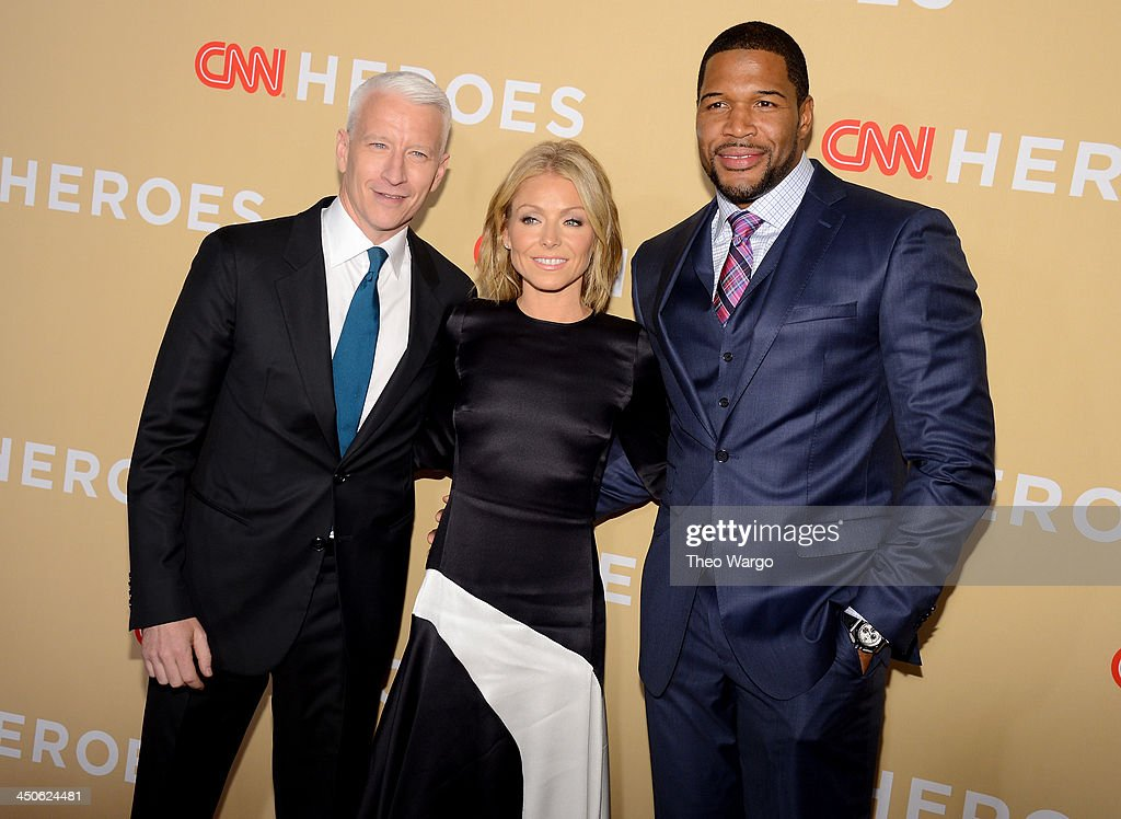 Host <a gi-track='captionPersonalityLinkClicked' href=/galleries/search?phrase=Anderson+Cooper&family=editorial&specificpeople=226776 ng-click='$event.stopPropagation()'>Anderson Cooper</a> poses with <a gi-track='captionPersonalityLinkClicked' href=/galleries/search?phrase=Kelly+Ripa&family=editorial&specificpeople=202134 ng-click='$event.stopPropagation()'>Kelly Ripa</a> and <a gi-track='captionPersonalityLinkClicked' href=/galleries/search?phrase=Michael+Strahan&family=editorial&specificpeople=210563 ng-click='$event.stopPropagation()'>Michael Strahan</a> at the 2013 CNN Heroes: An All Star Tribute at The American Museum of Natural History on November 19, 2013 in New York City. 24079_013_0125.JPG