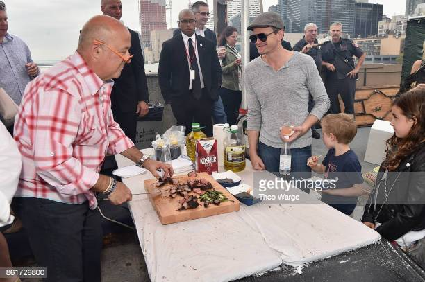 Host Andrew Zimmern and actor Neil Patrick Harris attend the Food Network Cooking Channel New York City Wine Food Festival Presented By CocaCola...
