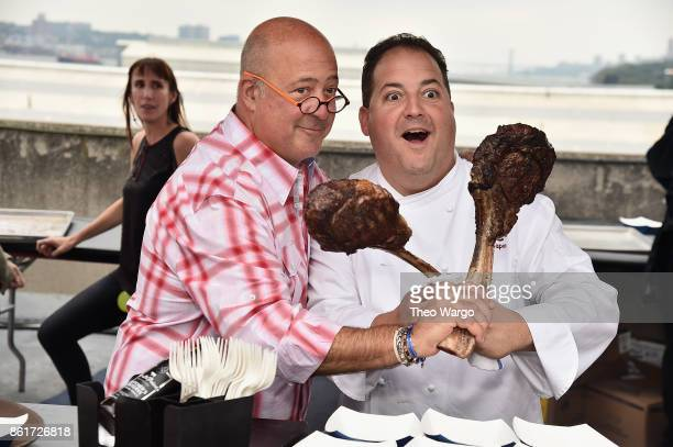 Host Andrew Zimmern and chef Josh Capon attend the Food Network Cooking Channel New York City Wine Food Festival Presented By CocaCola CocaCola...