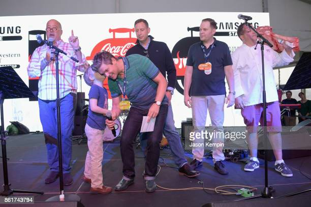 Host Andrew Zimmern Gideon Scott BurtkaHarris Host David Burtka Andrew Zimmern and Pat LaFrieda Mark Pastore and Chef Josh Capon on stage at the Food...