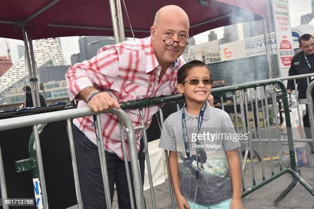 Host Andrew Zimmern greets guests at the Food Network Cooking Channel New York City Wine Food Festival Presented By CocaCola CocaCola Backyard BBQ...