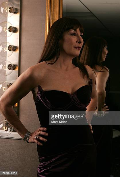 Host Anjelica Huston poses backstage during the 8th Annual Costume Designers Guild Awards held at the Beverly Hilton Hotel on February 25 2006 in...
