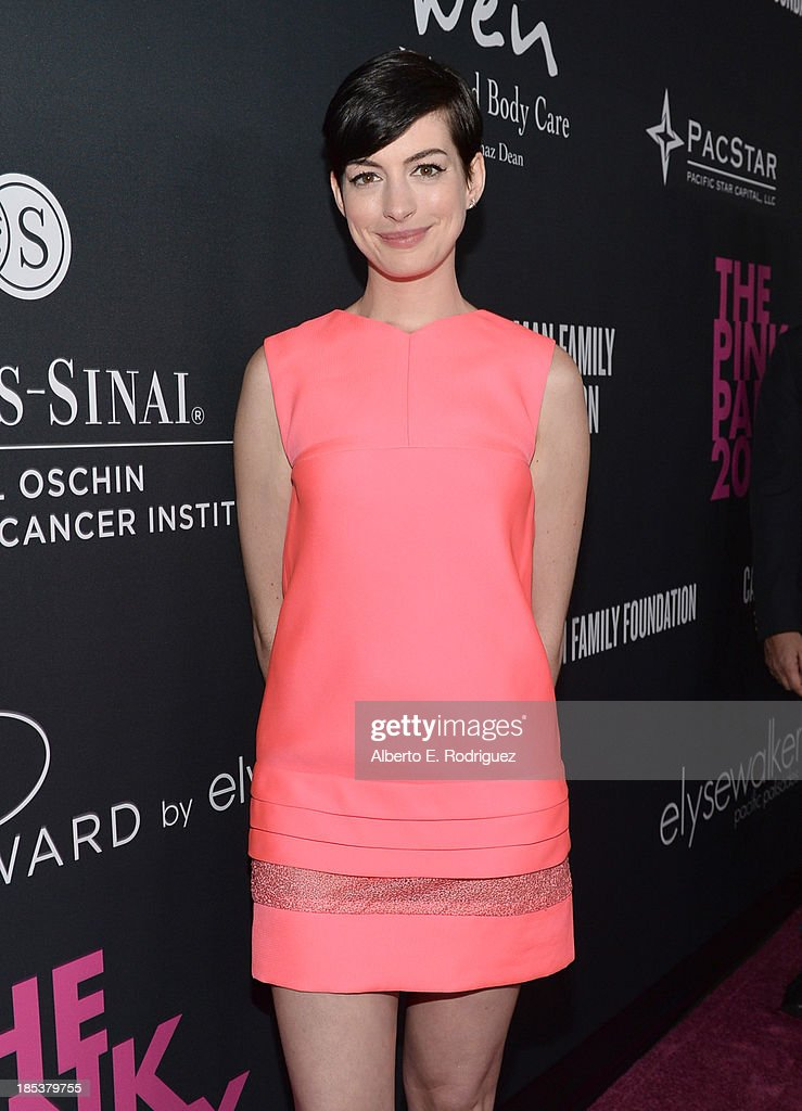Host Anne Hathaway attends Elyse Walker Presents The Pink Party 2013 hosted by Anne Hathaway at Barker Hangar on October 19, 2013 in Santa Monica, California.