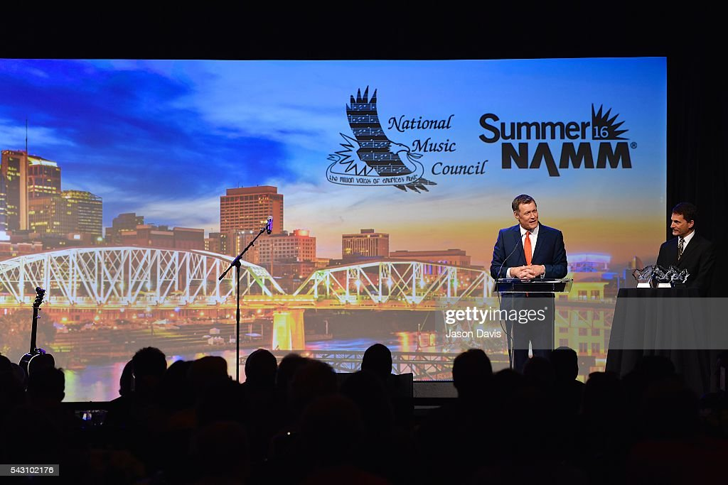 Host / Announcer, Grand Ole Opry - Bill Cody presents an American Eagle Award at 33rd Annual American Eagle Awards during Music Industry Day at Summer NAMM in Music City Center on June 25, 2016 in Nashville, Tennessee.