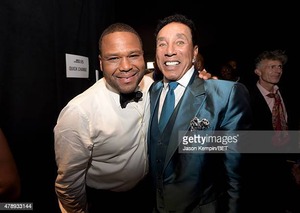 Host Anthony Anderson and honoree Smokey Robinson pose backstage during the 2015 BET Awards at the Microsoft Theater on June 28 2015 in Los Angeles...