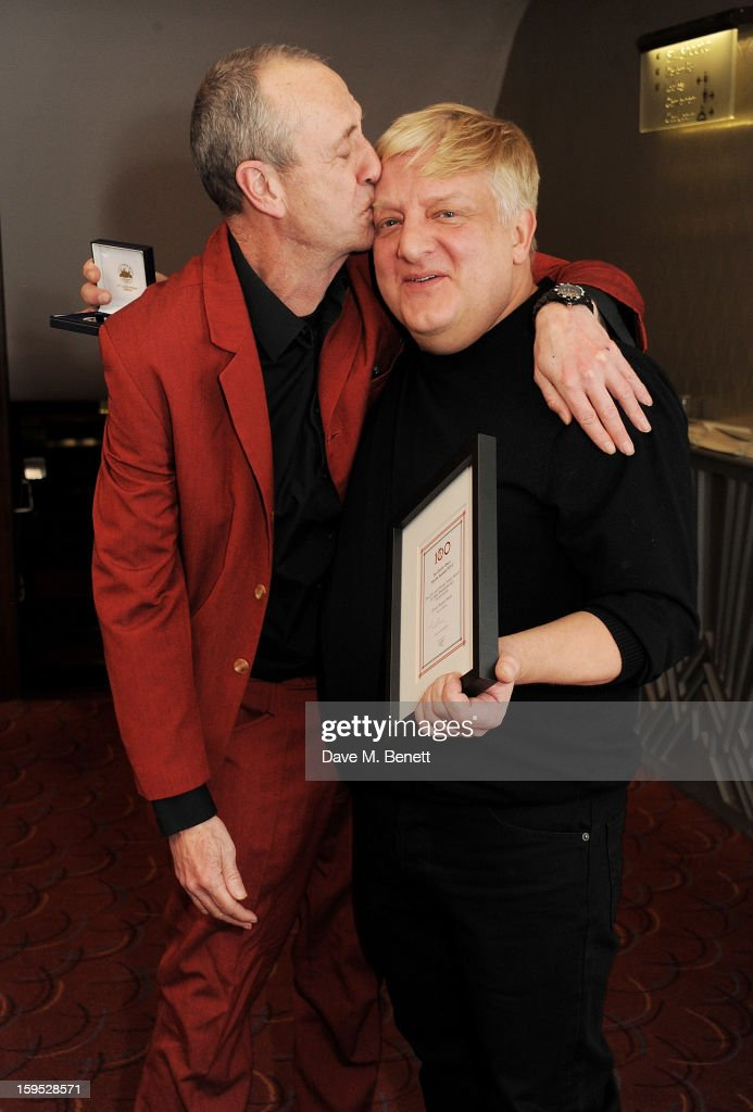 Host Arthur Smith (L) and Simon Russell Beale, winner of the John and Wendy Trewin Award for best Shakespearean Performance, attend the 2013 Critics' Circle Theatre Awards at the Prince Of Wales Theatre on January 15, 2013 in London, England.