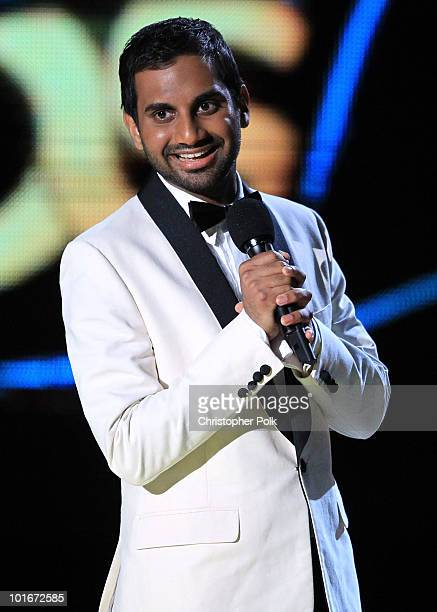 Host Aziz Ansari speaks onstage at the 2010 MTV Movie Awards held at the Gibson Amphitheatre at Universal Studios on June 6 2010 in Universal City...