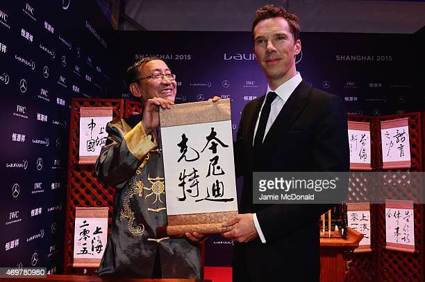 Host Benedict Cumberbatch poses with a Chinese sign at the 2015 Laureus World Sports Awards at Shanghai Grand Theatre on April 15 2015 in Shanghai...