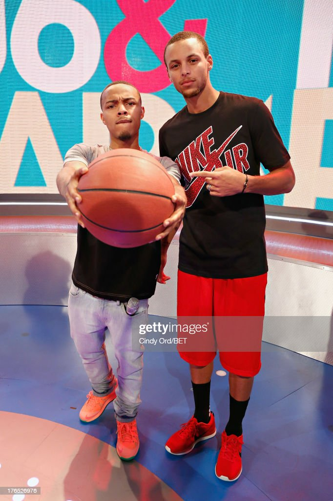 Host <a gi-track='captionPersonalityLinkClicked' href=/galleries/search?phrase=Bow+Wow+-+Rapper&family=editorial&specificpeople=211211 ng-click='$event.stopPropagation()'>Bow Wow</a> poses with professional basketball player Stephen Curry on stage at BET's '106 and Park' at BET Studios BET Studios on August 14, 2013 in New York City.