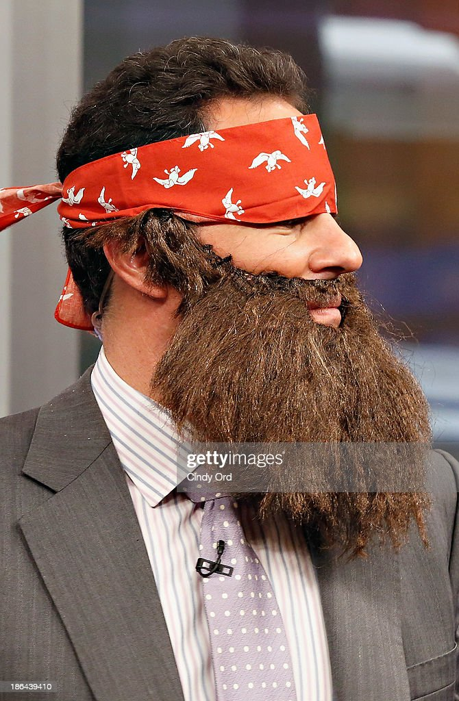 Host Brian Kilmeade wears a 'Duck Dynasty' costume as 'FOX & Friends' celebrates Halloween at FOX Studios on October 31, 2013 in New York City.