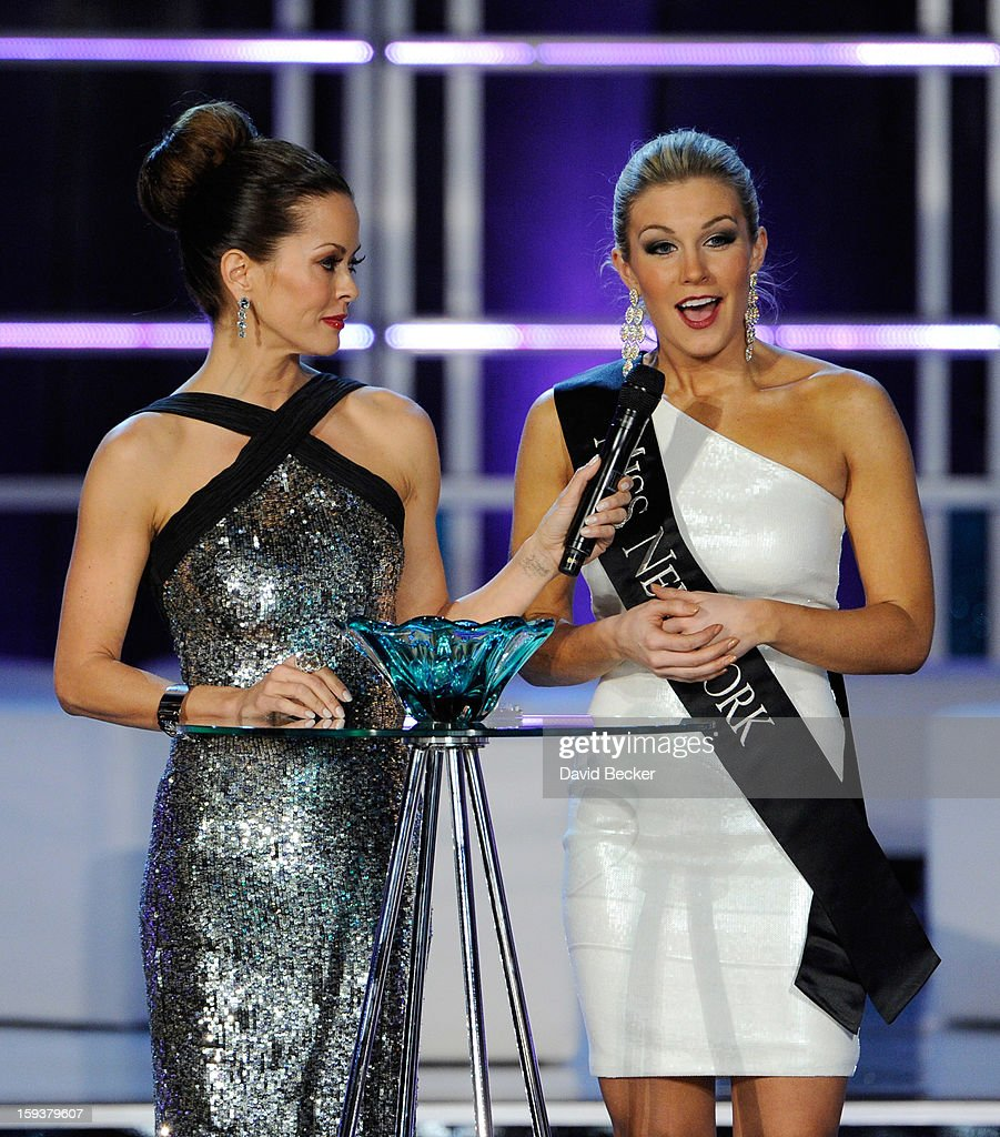 Host Brooke Burke Charvet (L) holds a microphone for Mallory Hytes Hagan, Miss New York, as she answers a question during the interview portion at the 2013 Miss America Pageant at PH Live at Planet Hollywood Resort & Casino on January 12, 2013 in Las Vegas, Nevada. Hagan went on to be crowned the new Miss America.