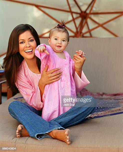 TV host Brooke Burke is photographed with daughter Sierra Sky for In Touch Weekly on February 18 2003 at home in Los Angeles California
